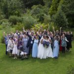 Group shot of wedding guests from hotel window