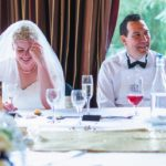 Bride and Groom enjoying reception speeches